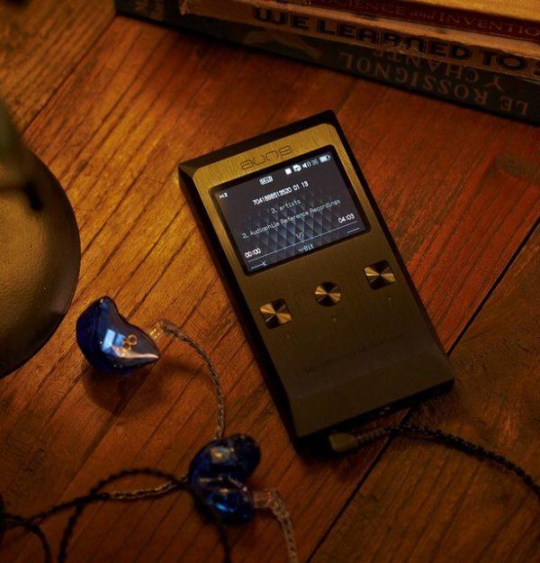Aune M2 Pro with headphones